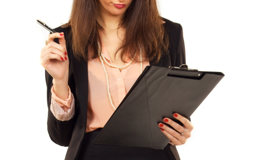 Professional Woman looking over tenant checklist